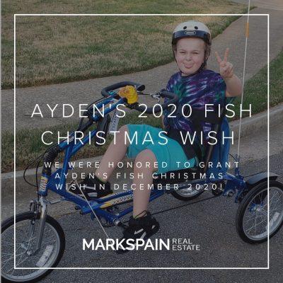 Mark Spain Real Estate grants local boy bike for Fish Christmas Wish