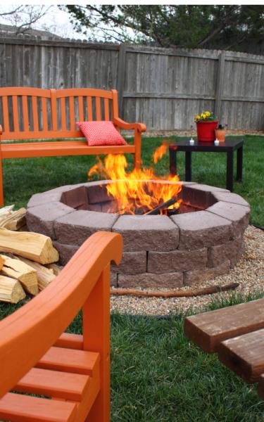 A fire burns in an outdoor fire pit